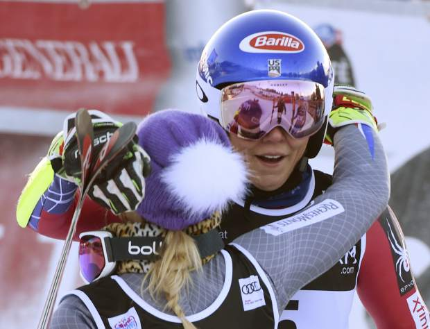 United States's Mikaela Shiffrin, right, the winner, embraces runner-up France's Tessa Worley after crossing the finish line of an alpine ski, women's World Cup giant slalom in Courchevel, France, Tuesday, Dec. 19, 2017. (AP Photo/Marco Tacca)