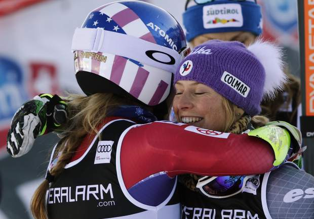 United States's Mikaela Shiffrin, left, the winner, embraces runner-up France's Tessa Worley in the finish area during an alpine ski, women's World Cup giant slalom in Courchevel, France, Tuesday, Dec. 19, 2017. (AP Photo/Gabriele Facciotti)