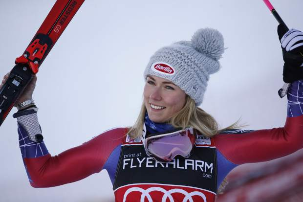 United States's Mikaela Shiffrin celebrates in the finish area after winning an alpine ski, women's World Cup giant slalom in Courchevel, France, Tuesday, Dec. 19, 2017. (AP Photo/Gabriele Facciotti)