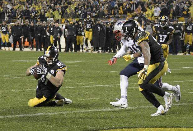 Pittsburgh Steelers tight end Jesse James (81) has a knee down before crossing the goal line with a pass from quarterback Ben Roethlisberger during the second half of an NFL football game against the New England Patriots in Pittsburgh, Sunday, Dec. 17, 2017. The Patriots won 27-24. (AP Photo/Don Wright)