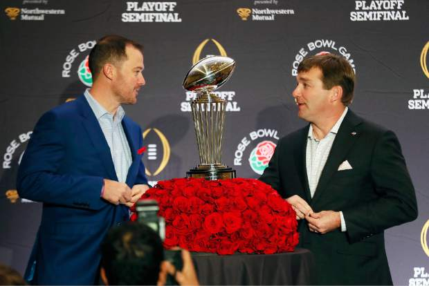 Oklahoma head coach Lincoln Riley, left, and Georgia head coach Kirby Smart speak before a photo session at an NCAA college football news conference, Sunday, Dec. 31, 2017, in Los Angeles. Oklahoma and Georgia meet at the Rose Bowl in a College Football Playoff semifinal on New Year's Day. (Bob Andres/Atlanta Journal-Constitution via AP)
