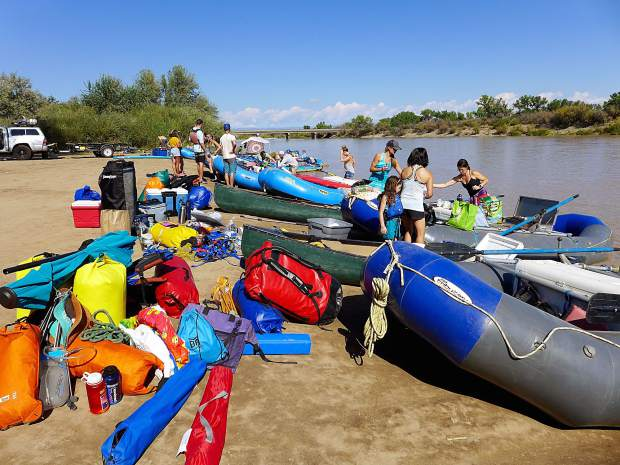 A group of rafters in Fruita prepare for a river trip on the Colorado River this summer. Many water professionals in Colorado are working to educate people about water, and many people's interest in the subject is formed by a recreational river trip.