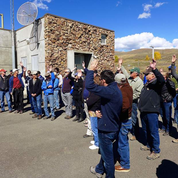 Members of the Colorado River basin roundtable raise their hands during a tour of the Windy Gap Reservoir in September. Water education, on both the Western Slope and the Front Range, often involves tours of water storage and transport facilities.