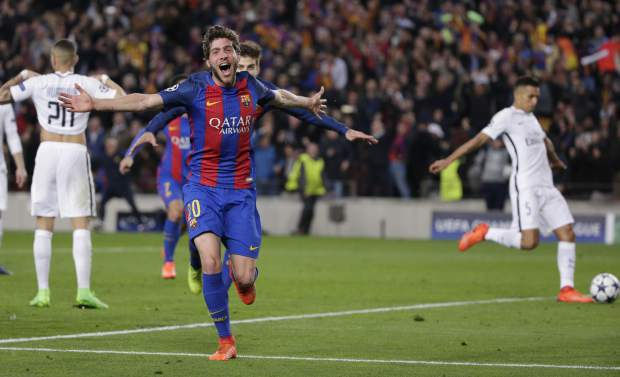 FILE - In this March 8, 2017, file photo, Barcelona's Sergi Roberto celebrates after scoring their sixth goal during a Champions League round of 16, second leg soccer match against Paris Saint Germain at the Camp Nou stadium in Barcelona, Spain. Barcelona won 6-1. (AP Photo/Emilio Morenatti, File)