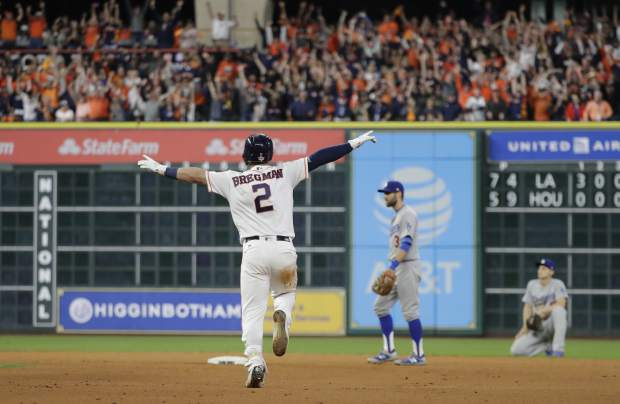 FILE - In this Oct. 30, 2017, file photo, Houston Astros' Alex Bregman reacts after driving in the game-winning run in the 10th inning of Game 5 of baseball's World Series against the Los Angeles Dodgers in Houston. The Astros won 13-12. (AP Photo/David J. Phillip, File)