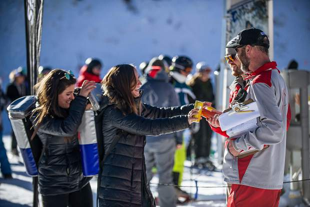 The Red Bull girls hand out free energy drinks to people at Base Village in Snowmass on Friday for the 50th anniversary.