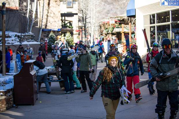 Groups walk through the mall on Friday for the 50th anniversary celebrations in Snowmass.