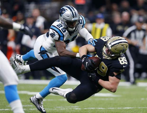 New Orleans Saints tight end Josh Hill (89) pulls in a pass reception over Carolina Panthers strong safety Mike Adams (29) in the first half of an NFL football game in New Orleans, Sunday, Jan. 7, 2018. (AP Photo/Butch Dill)