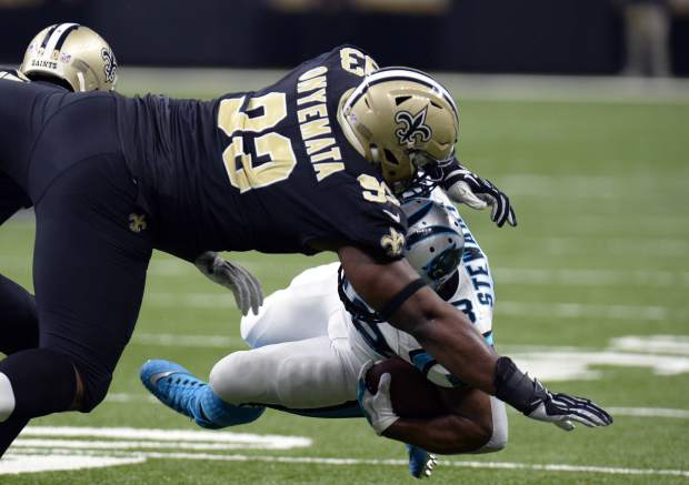 New Orleans Saints defensive tackle David Onyemata (93) tackles Carolina Panthers running back Jonathan Stewart (28) in the first half of an NFL football game in New Orleans, Sunday, Jan. 7, 2018. (AP Photo/Bill Feig)