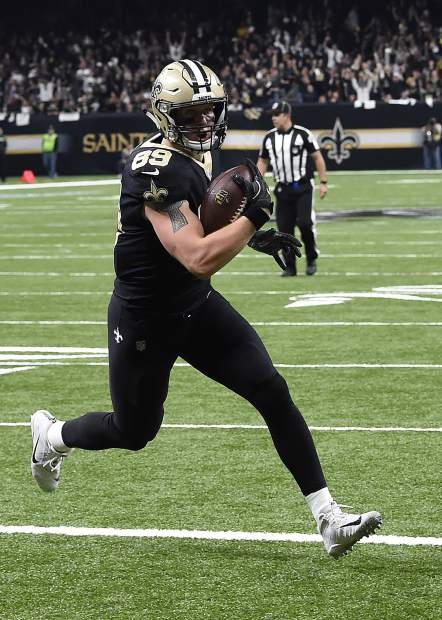 New Orleans Saints tight end Josh Hill (89), crosses the goal line on a touchdown reception in the first half of an NFL football game against the Carolina Panthers in New Orleans, Sunday, Jan. 7, 2018. (AP Photo/Bill Feig)