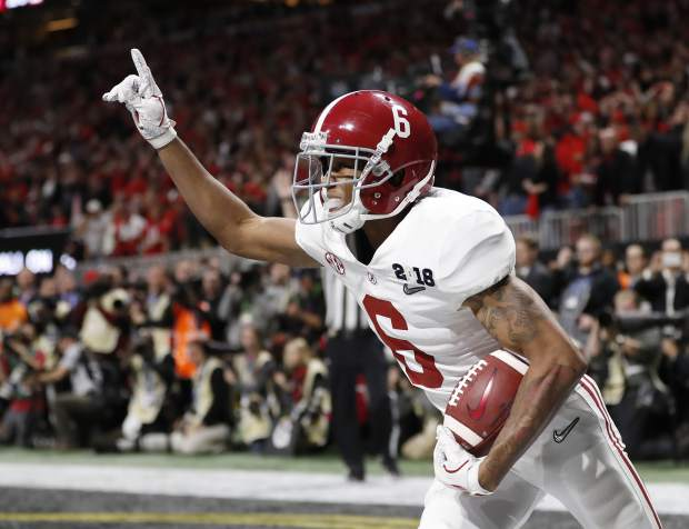 Alabama wide receiver DeVonta Smith scored the game-winning touchdown in overtime of the NCAA college football playoff championship game against Georgia, Monday in Atlanta. Alabama won 26-23.