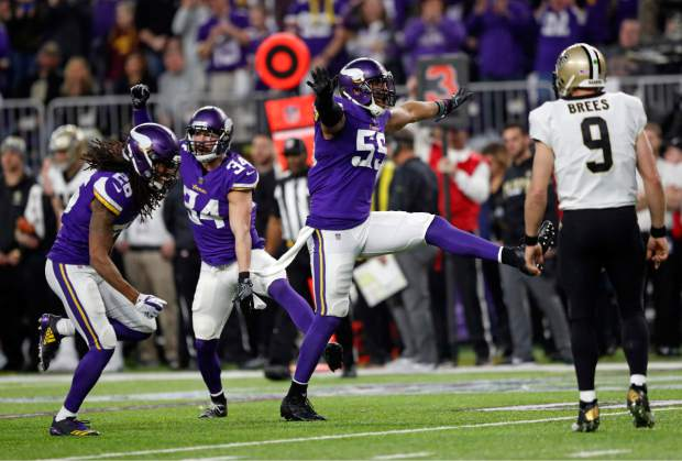 Minnesota Vikings strong safety Andrew Sendejo (34) celebrates his interception with cornerback Trae Waynes (26) and outside linebacker Anthony Barr (55) as New Orleans Saints quarterback Drew Brees (9) looks on during the first half of an NFL divisional football playoff game in Minneapolis, Sunday, Jan. 14, 2018. (AP Photo/Charlie Neibergall)