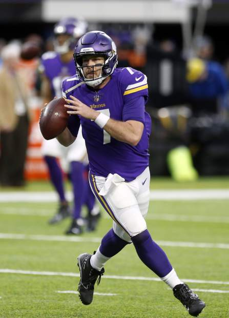 Minnesota Vikings quarterback Case Keenum (7) throws before an NFL divisional football playoff game against the New Orleans Saints in Minneapolis, Sunday, Jan. 14, 2018. (AP Photo/Jim Mone)