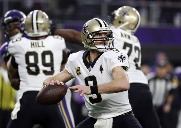 New Orleans Saints quarterback Drew Brees (9) throws against the Minnesota Vikings during the first half of an NFL divisional football playoff game in Minneapolis, Sunday, Jan. 14, 2018. (AP Photo/Jeff Roberson)
