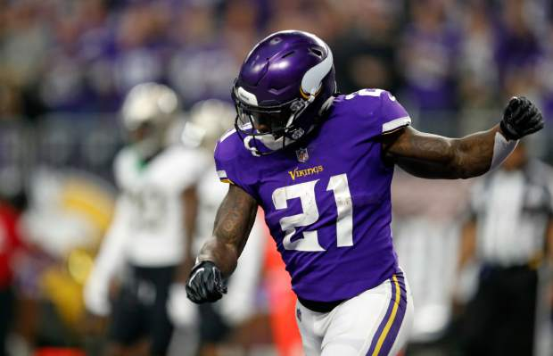 Minnesota Vikings running back Jerick McKinnon (21) celebrates a touchdown against the New Orleans Saints during the first half of an NFL divisional football playoff game in Minneapolis, Sunday, Jan. 14, 2018. (AP Photo/Charlie Neibergall)