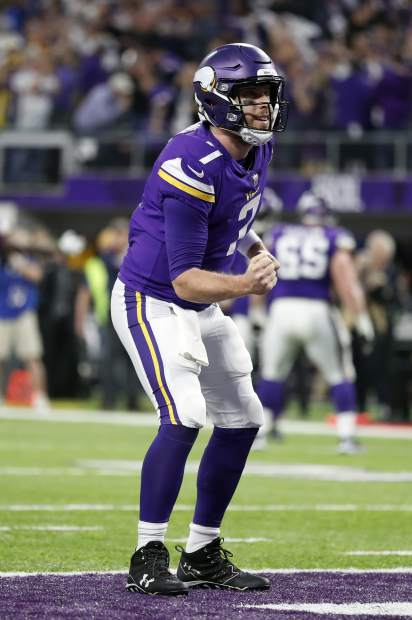 Minnesota Vikings quarterback Case Keenum (7) celebrates a touchdown by running back Latavius Murray during the first half of an NFL divisional football playoff game against the New Orleans Saints in Minneapolis, Sunday, Jan. 14, 2018. (AP Photo/Jeff Roberson)