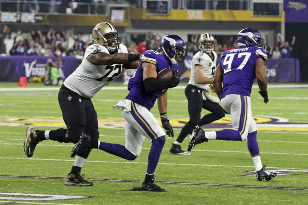 Minnesota Vikings outside linebacker Anthony Barr (55) is hit by New Orleans Saints offensive tackle Terron Armstead (72) after making an interception during the first half of an NFL divisional football playoff game in Minneapolis, Sunday, Jan. 14, 2018. (AP Photo/Jim Mone)