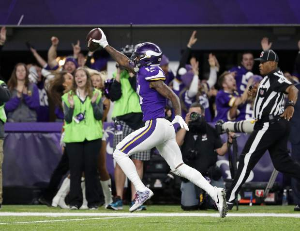 Minnesota Vikings wide receiver Stefon Riggs (14) runs in for a game winning touchdown against the New Orleans Saints during the second half of an NFL divisional football playoff game in Minneapolis, Sunday, Jan. 14, 2018. The Vikings defeated the Saints 29-24. (AP Photo/Jeff Roberson)
