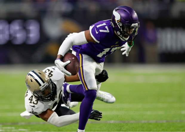 Minnesota Vikings wide receiver Jarius Wright (17) is tackled by New Orleans Saints free safety Marcus Williams (43) after a catch during the first half of an NFL divisional football playoff game in Minneapolis, Sunday, Jan. 14, 2018. (AP Photo/Charlie Neibergall)