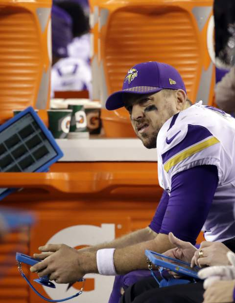 Minnesota Vikings' Case Keenum sits on the bench during the second half of the NFL football NFC championship game against the Philadelphia Eagles Sunday, Jan. 21, 2018, in Philadelphia. (AP Photo/Matt Rourke)
