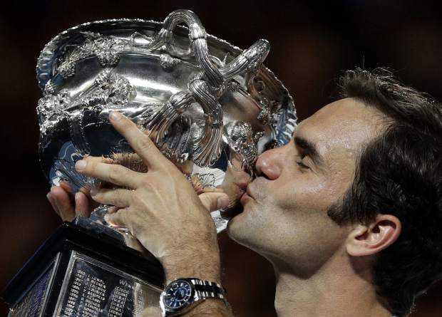 Switzerland's Roger Federer holds his trophy aloft after defeating Croatia's Marin Cilic during the men's singles final at the Australian Open tennis championships in Melbourne, Australia, Sunday, Jan. 28, 2018. (AP Photo/Dita Alangkara)
