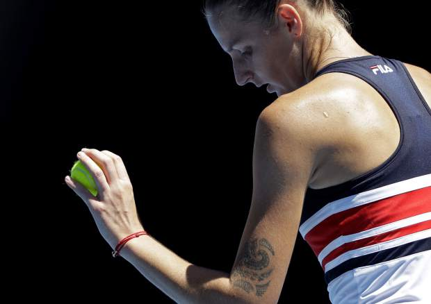 Karolina Pliskova of the Czech Republic prepares to serve to Paraguay's Veronica Cepede Royg during their first round match at the Australian Open tennis championships in Melbourne, Australia, Tuesday, Jan. 16, 2018. (AP Photo/Dita Alangkara )