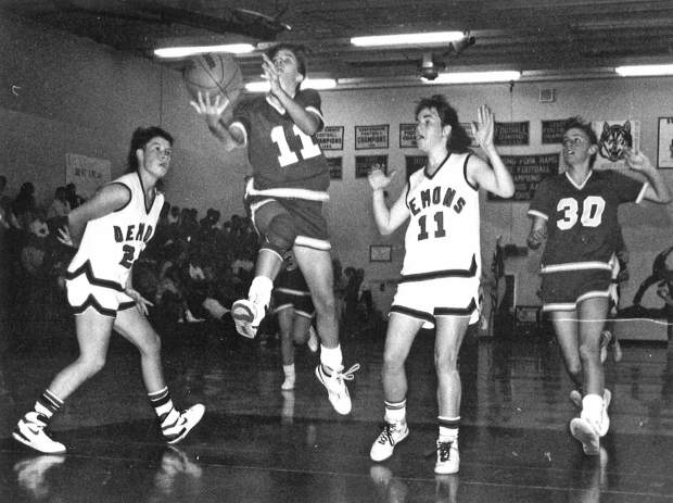 Tricia Bader takes it to the hoop against the Glenwood Springs Demons during her high school playing days.