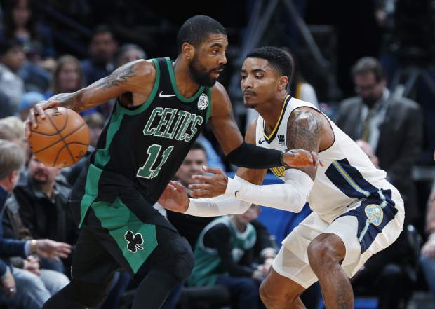 Boston Celtics guard Kyrie Irving, left, drives past Denver Nuggets guard Gary Harris in the first half of an NBA basketball game Monday, Jan. 29, 2018, in Denver. (AP Photo/David Zalubowski)