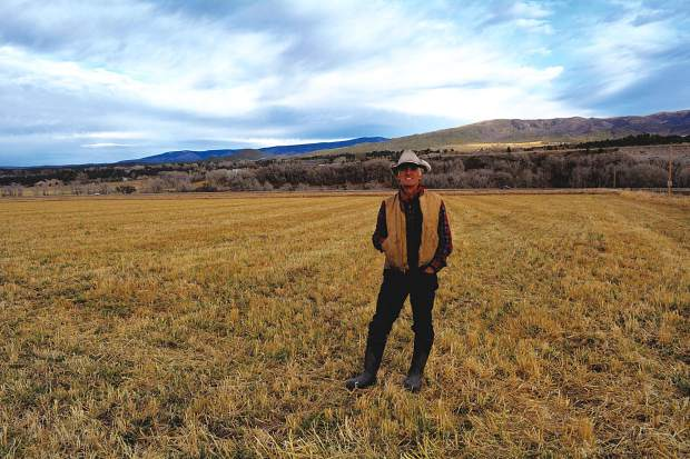 Bill Fales stands on his ranch overlooking the Crystal River south of Carbondale. His property is one of the last true operating ranches in Pitkin County.