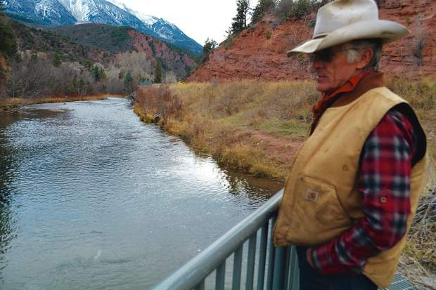 Rancher Bill Fales stands next to his headgate on the Crystal River. Under a water leasing arrangement with the Colorado Water Trust, Fales offered to turn off the headgate for one of his irrigation ditches to help boost water levels in exchange for payment.