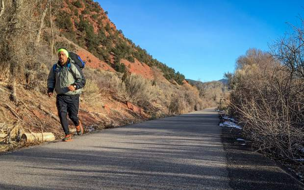 A runner uses the Rio Grande Trail near the Riverview School on Monday afternoon in the area where a jogger recently reported an aggresive coyote.