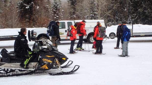 Garfield County Search and Rescue members get ready to head into the back country.