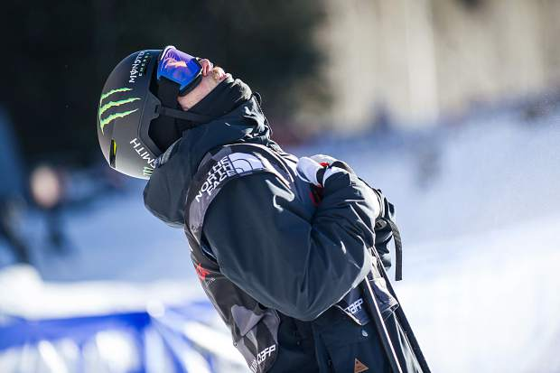 American skier Gus Kenworthy sighs with relief after stomping his second run securing his spot in the Olympics and also putting him into first place for the men's ski slopestyle finals in Snowmass on Sunday. Kenworthy won from his second run score of 95.40.