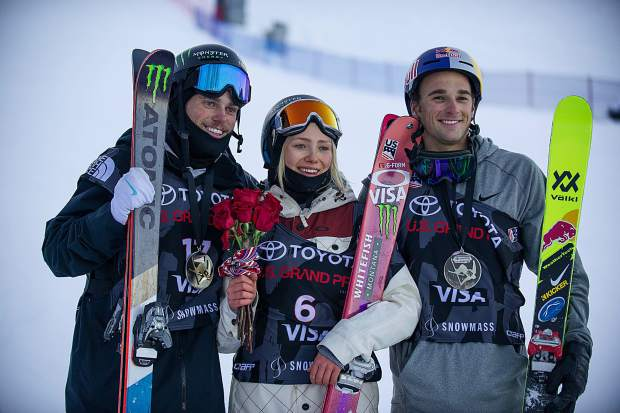 From left to right, U.S. skiers, Gus Kenworthy, Maggie Voisin, and Nick Goepper pose for a photo after all being on the podium for the slopestyle finals in Snowmass on Sunday. Kenworthy took first and secured an Olympic spot, Goepper second and Voisin took second in the women's slopestyle.