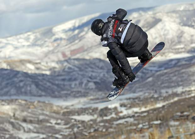 Shaun White competes in Thursday's men's snowboard halfpipe qualifier at the U.S. Grand Prix in Snowmass. White recorded the best score from either heat to make Saturday's final.