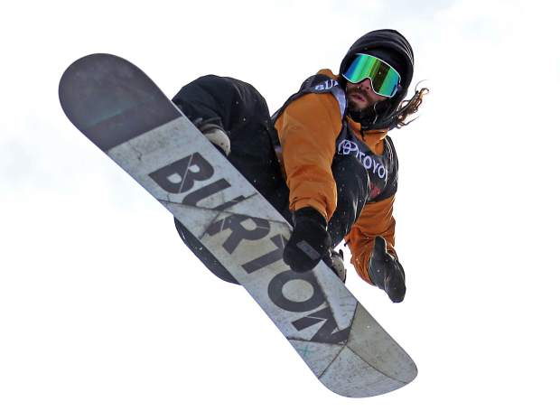 Danny Davis competes in Thursday's men's snowboard halfpipe qualifier at the U.S. Grand Prix in Snowmass. Davis was fourth in his heat and will compete in Saturday's final.