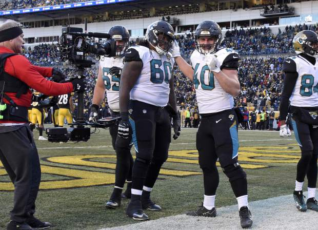 Jacksonville Jaguars fullback Tommy Bohanon (40) celebrates his touchdown during the second half of an NFL divisional football AFC playoff game against the Pittsburgh Steelers in Pittsburgh, Sunday, Jan. 14, 2018. (AP Photo/Don Wright)