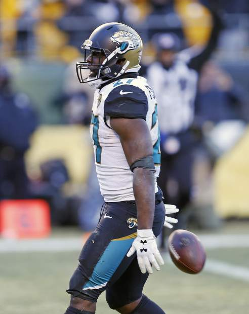 Jacksonville Jaguars running back Leonard Fournette (27) celebrates his touchdown during the second half of an NFL divisional football AFC playoff game in Pittsburgh, Sunday, Jan. 14, 2018. (AP Photo/Keith Srakocic)