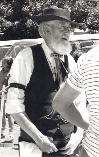 Al Maggard, with his distrinctive vest and bolo tie, at one of the many community events he was involved with over the years.