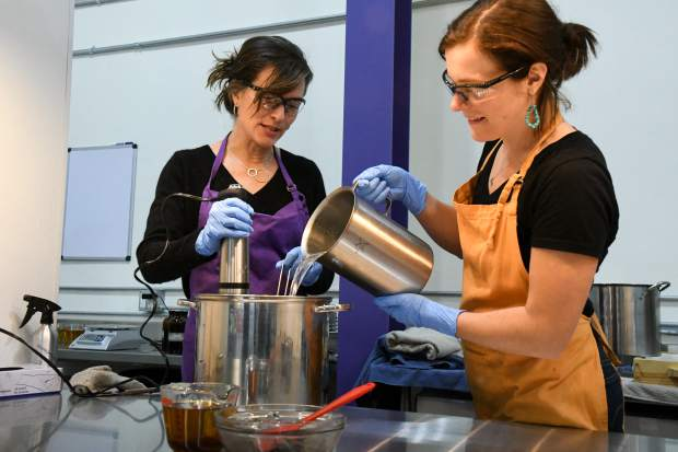 Osmia Organics founder Sarah Villafranco and soap maker Pola Oginski work together to make a batch of the Vetiver Grey soap.