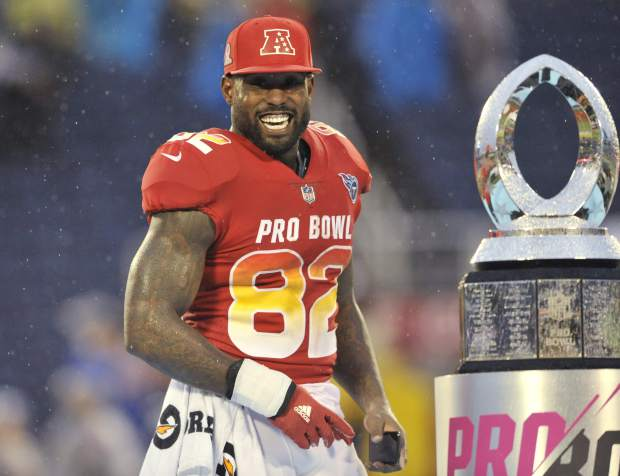 AFC tight end Delanie Walker (82), of the Tennessee Titans, smiles after winning the MVP Offensive Player of the game, at the NFL Pro Bowl football game, Sunday, Jan. 28, 2018, in Orlando, Fla. The AFC defeated the NFC 24-23. (AP Photo/Steve Nesius)