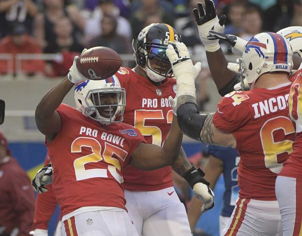 AFC running back LeSean McCoy (25) of the Buffalo Bills, celebrates a touchdown with center Maurkice Pouncey (53), of the Pittsburg Steelers and guard Richie Incognito (64), of the Buffalo Bills, during the second half of the NFL Pro Bowl football game, Sunday, Jan. 28, 2018, in Orlando, Fla. (AP Photo/Phelan M Ebenhack)