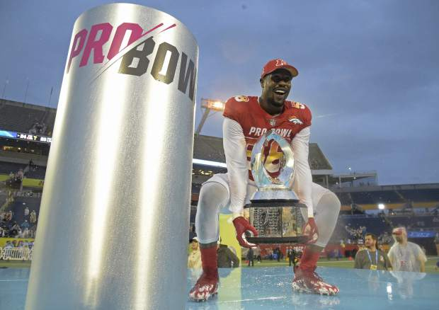 AFC linebacker Von Miller (58), of the Denver Broncos, raises the Pro Bowl trophy after defeating the AFC 24-23, Sunday, Jan. 28, 2018, in Orlando, Fla. Miller won the MVP for the Defensive Player of the Game. (AP Photo/Phelan M. Ebenhack)