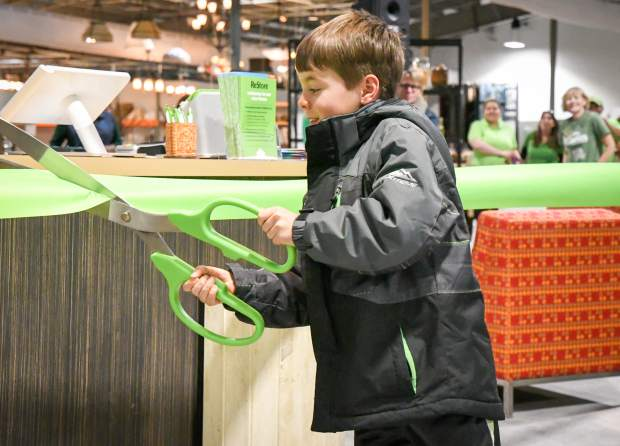 Six-year-old Harper French is the honorary ribbon cutter at the new Habitat for Humanity ReStore grand opening ceremony on Thursday afternoon.
