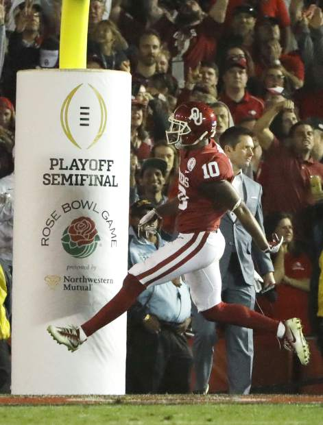 Oklahoma defensive back Steven Parker celebrates after recovering a fumble and scoring a touchdown against Georgia during the second half of the Rose Bowl NCAA college football game, Monday, Jan. 1, 2018, in Pasadena, Calif. (AP Photo/Gregory Bull)