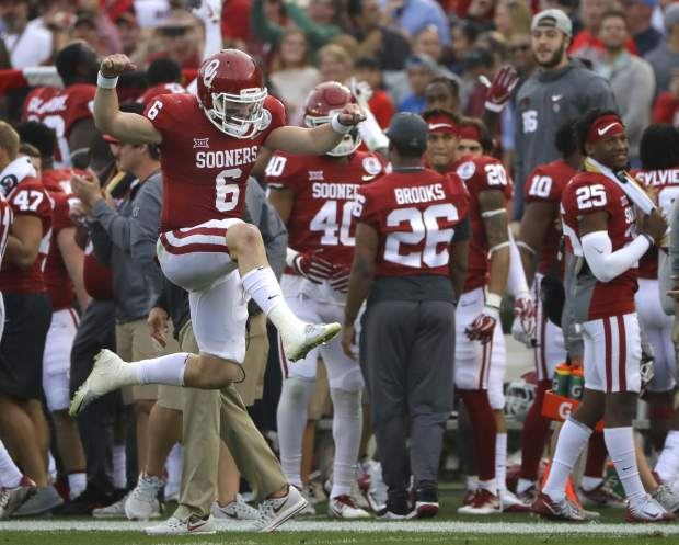 Oklahoma quarterback Baker Mayfield (6) leaps and celebrates after he scored a touchdown against Georgia during the first half of the Rose Bowl NCAA college football game Monday, Jan. 1, 2018, in Pasadena, Calif. (AP Photo/Gregory Bull)