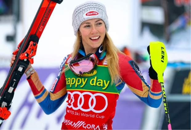 United States' Mikaela Shiffrin celebrates in the finish area after winning an alpine ski, women's World Cup slalom in Kranjska Gora, Slovenia, Sunday Jan. 7, 2018. (AP Photo/Marco Trovati)