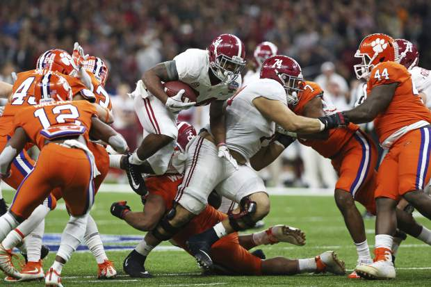 Alabama running back Damien Harris (34) carries in the first half of the Sugar Bowl semi-final playoff game against Clemson for the NCAA college football national championship, in New Orleans, Monday, Jan. 1, 2018. (AP Photo/Rusty Costanza)