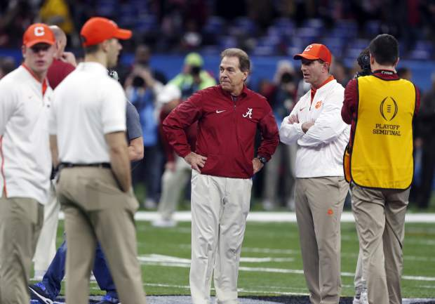 Alabama head coach Nick Saban, left, and Clemson head coach Dabo Swinney talk before the Sugar Bowl semi-final playoff game for the NCAA college football national championship, in New Orleans, Monday, Jan. 1, 2018. (AP Photo/Gerald Herbert)