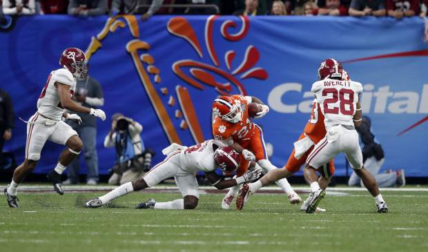 Clemson wide receiver Ray-Ray McCloud (21) is hit by Alabama defensive back Deionte Thompson (14) in the first half of the Sugar Bowl semi-final playoff game for the NCAA college football national championship, in New Orleans, Monday, Jan. 1, 2018. (AP Photo/Gerald Herbert)